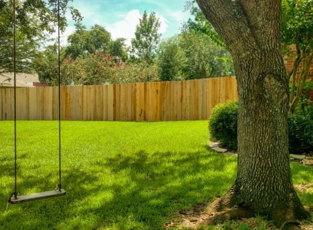 swing in the shade - fence stock photos and pictures