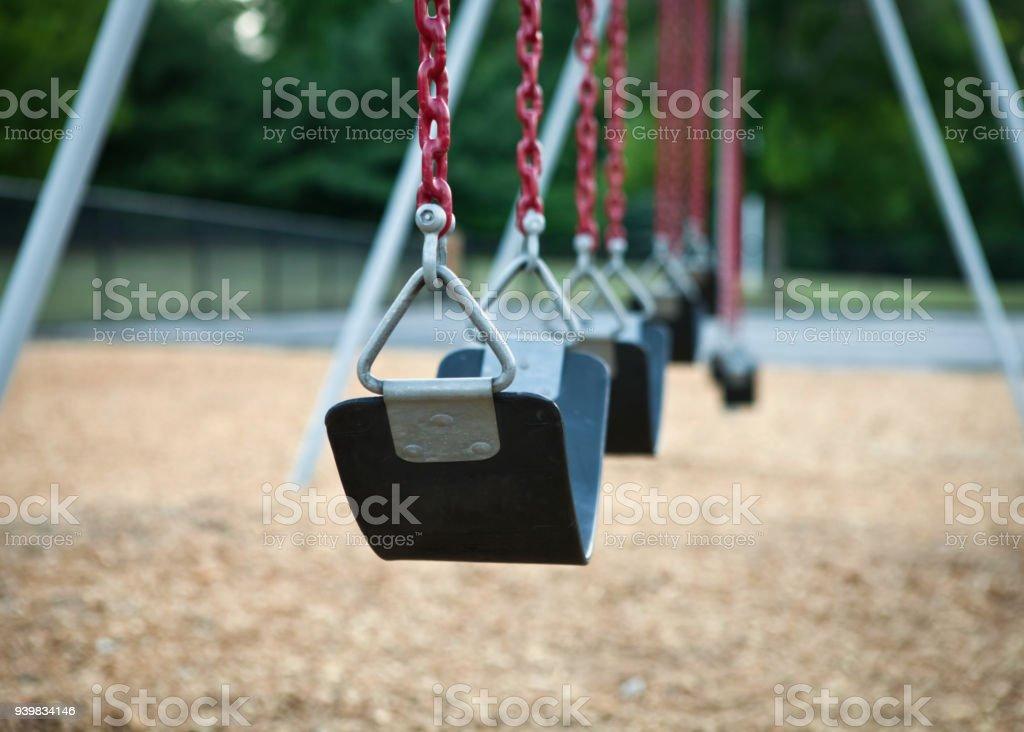 Swing on playground stock photo