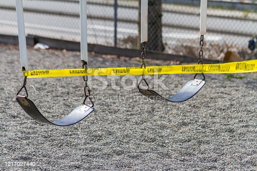 A set of swings are caution taped off during COVID-19 prevention measures.