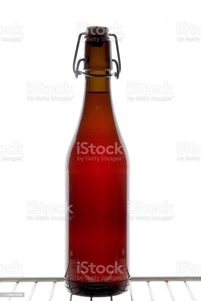 Swing top Bottle, on a cool box shelf royalty-free stock photo