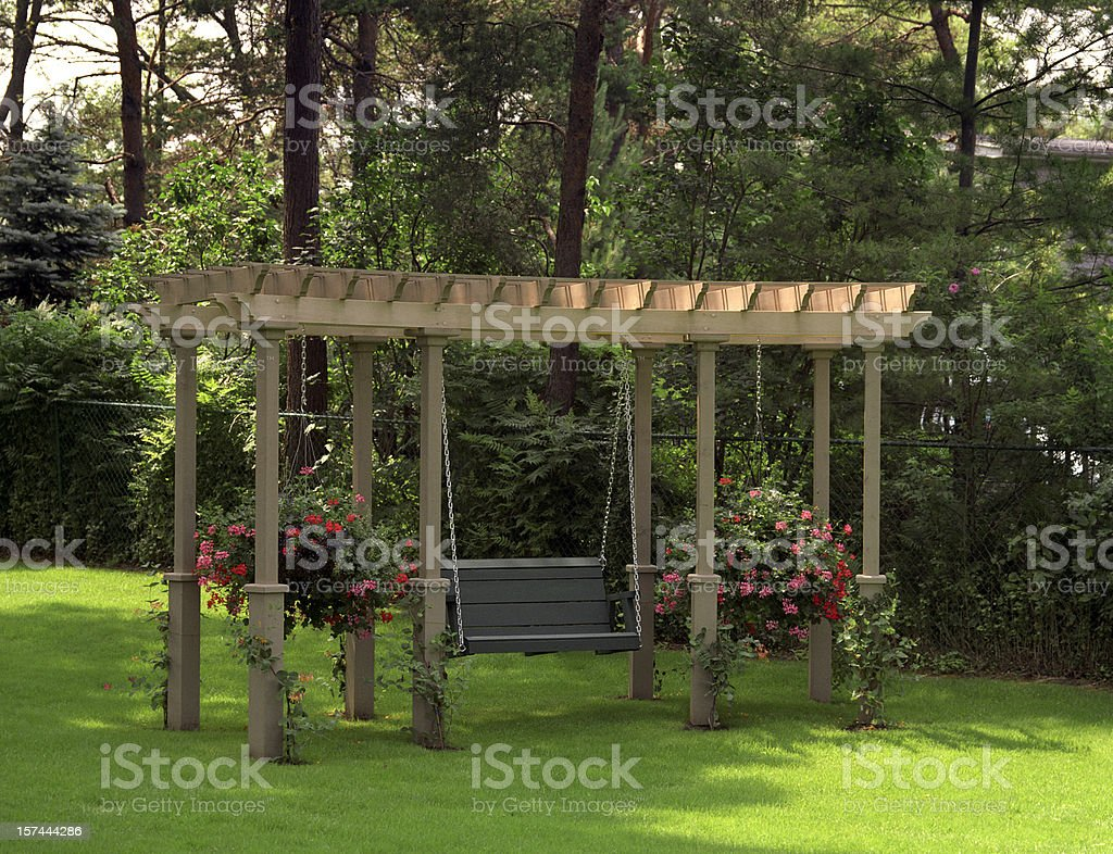 Swing under pergola stock photo