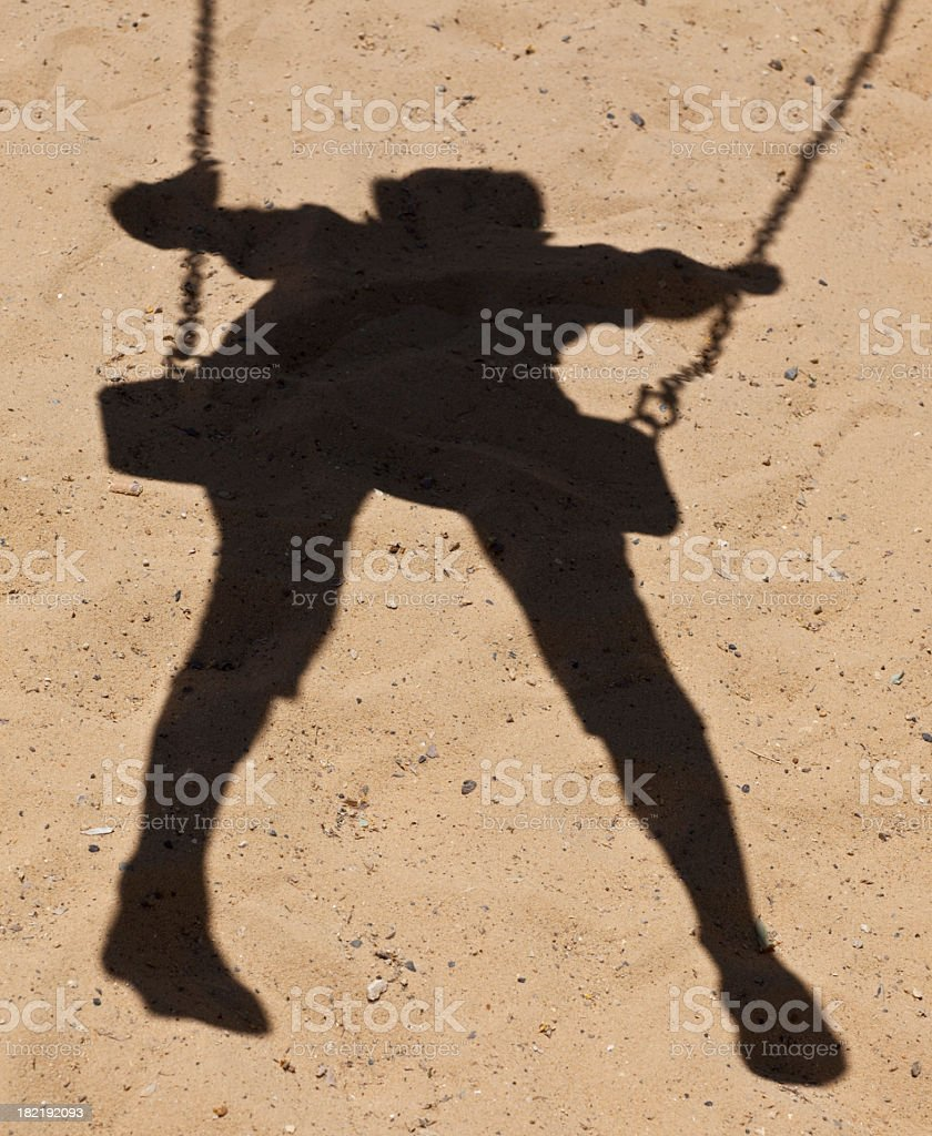 Swinging Child's shadow royalty-free stock photo