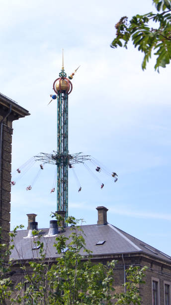 Swinging fair ride on Tivoli amusement park at Copenhagen stock photo