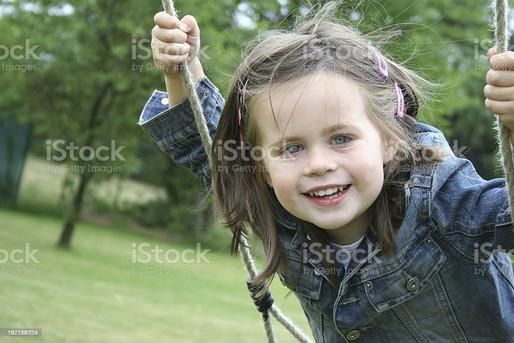 swinging girl stock photo