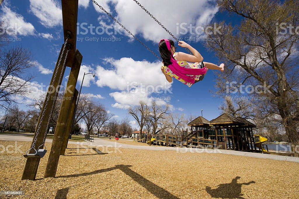 Swinging on a Sunny Day royalty-free stock photo