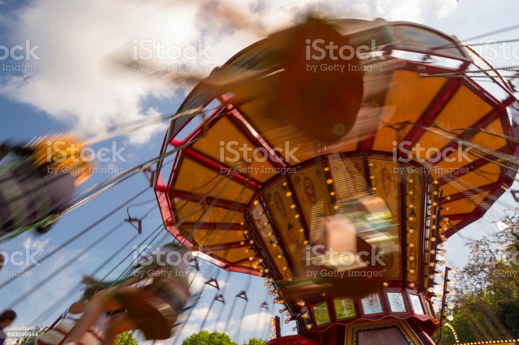 Swinging ride at a carnival with motion blur stock photo