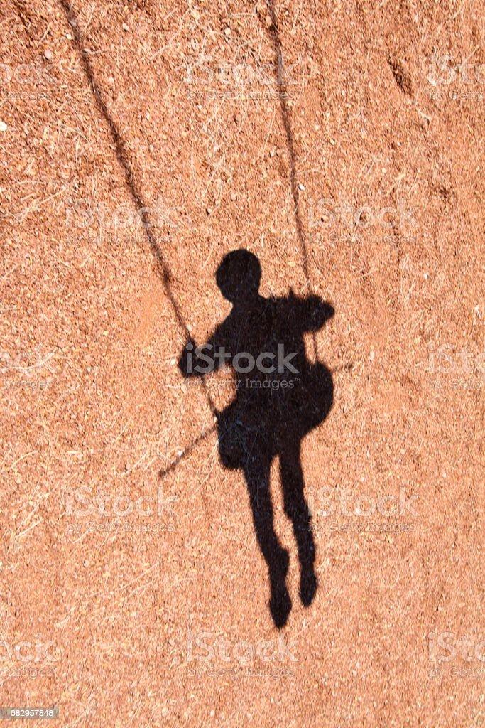 Swinging shadow royalty-free stock photo