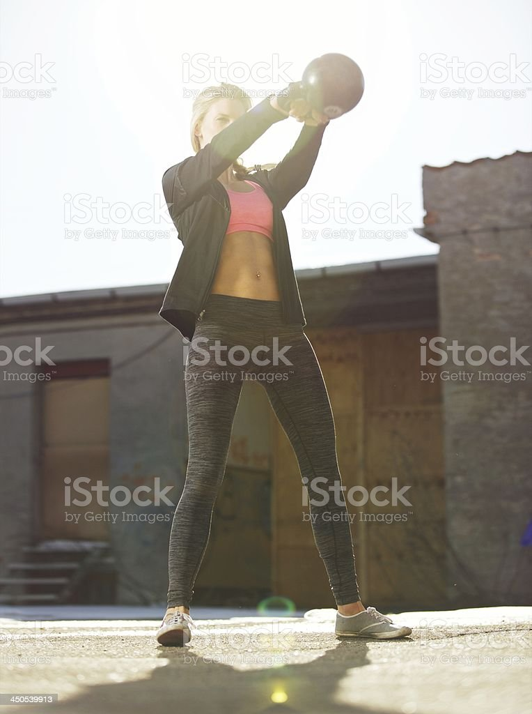 Swinging the Kettle bell Outdoors stock photo