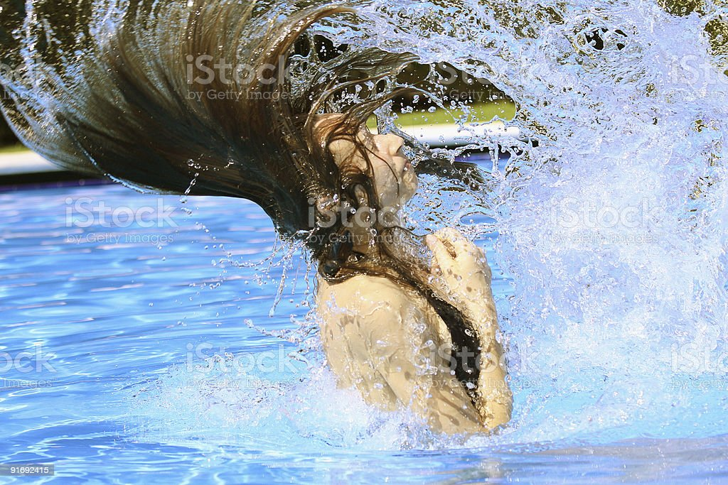 Swinging with hair in swimming pool royalty-free stock photo