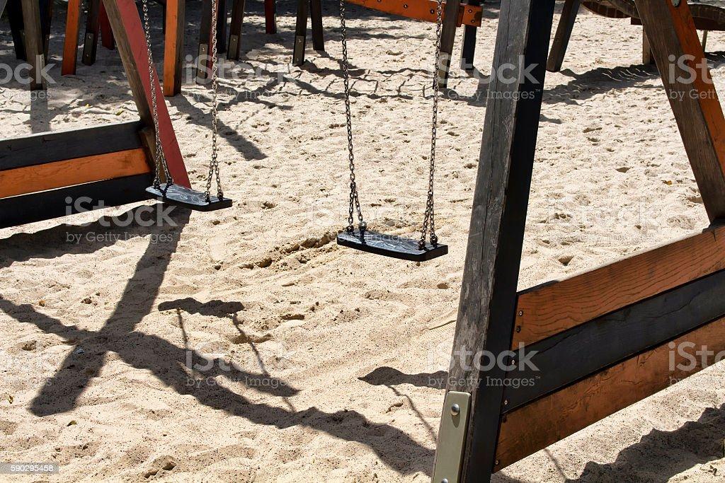 Swings at children playground at Tiergarten in Berlin Стоковые фото Стоковая фотография