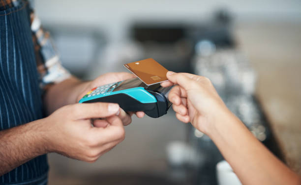 swipe and pay - paying with card contactless imagens e fotografias de stock