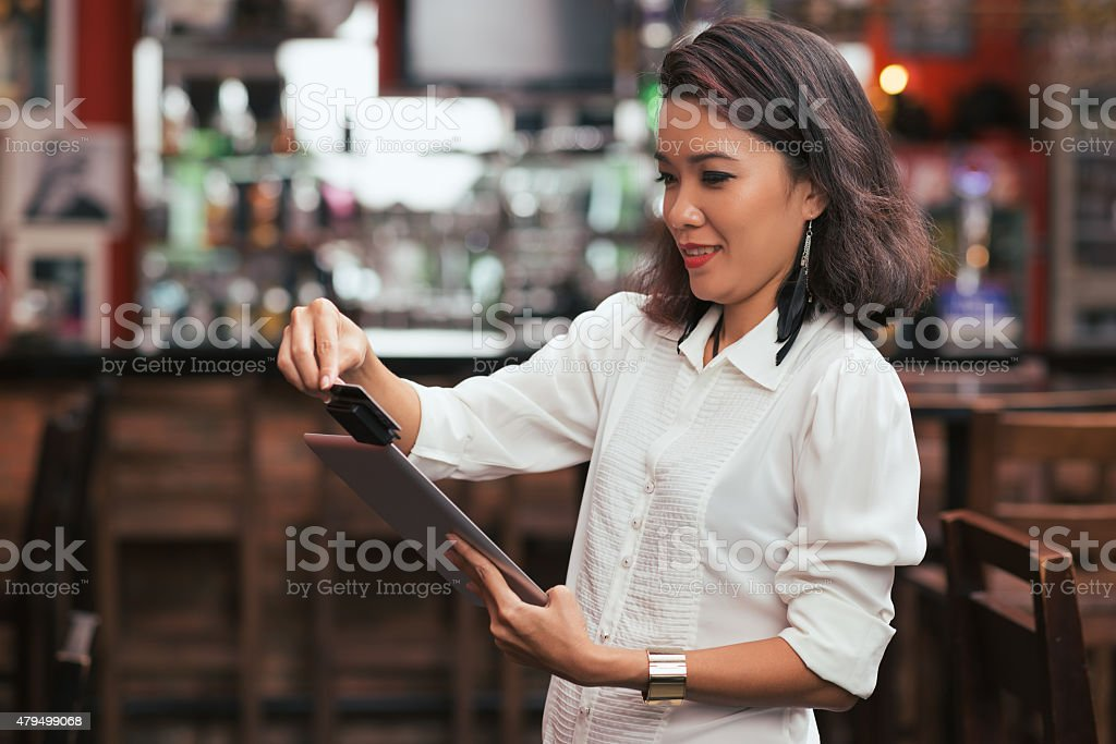 Swiping card payment stock photo