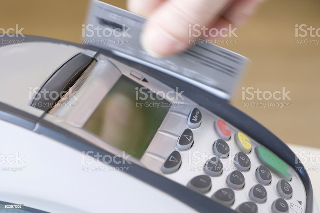 Swiping Credit Card  Blurred Motion Stock Photo