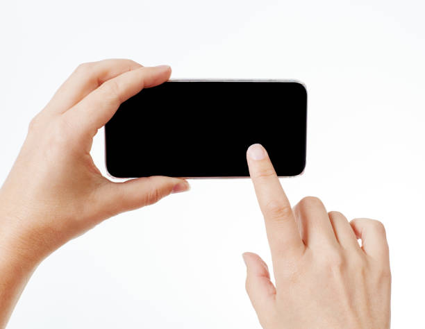 Swiping left - or right on smart phone stock photo