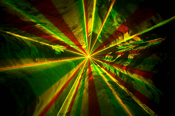 Swirling beams of light produced during RGY laser aerial display stock photo