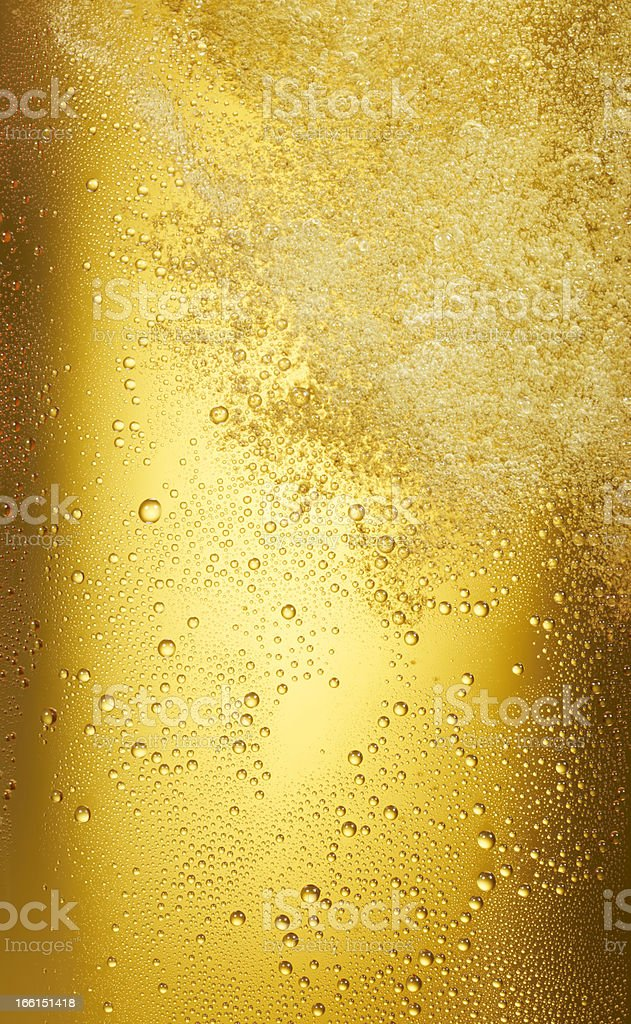 swirling beer with dewdrops stock photo