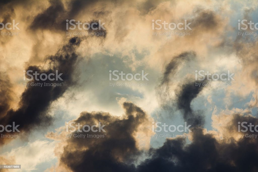 Swirling Clouds at Sunset stock photo