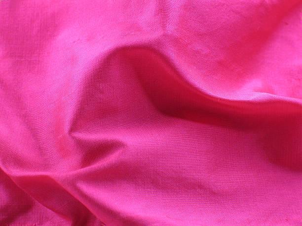 Swirling folds of pink raw silk stock photo