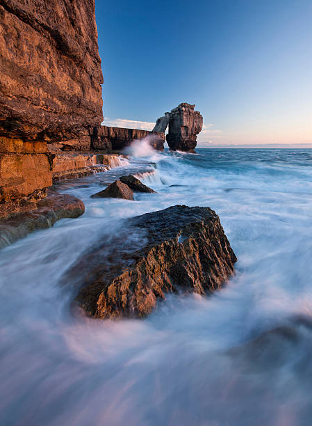 Swirling tide at Pulpit Rock, Portland, UK stock photo