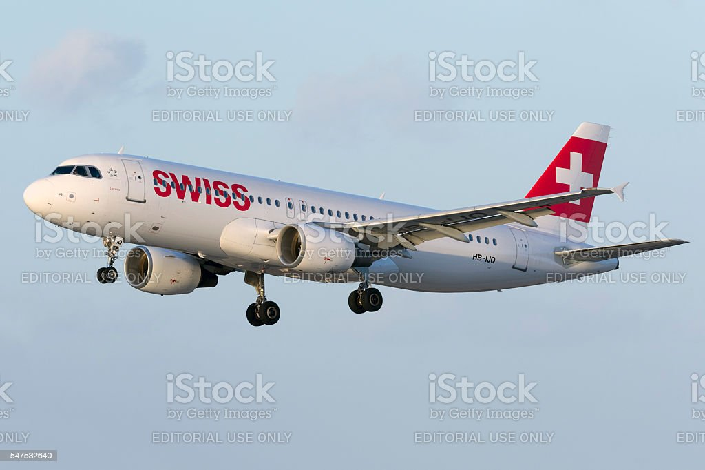 Swiss Air A320 landing in the evening stock photo