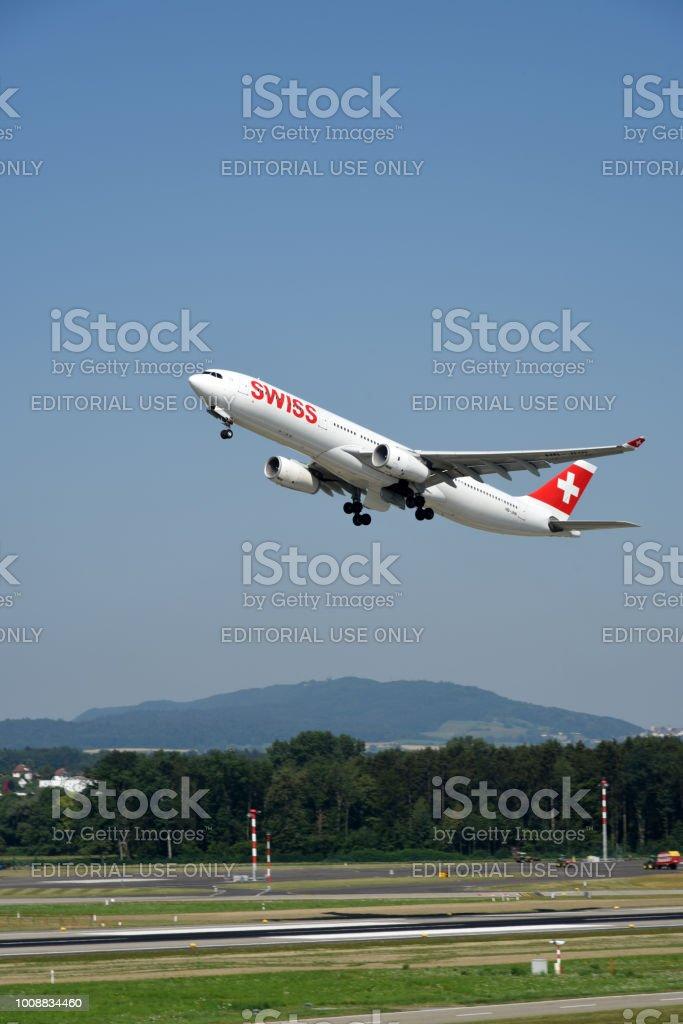 Swiss aircraft takeoff stock photo