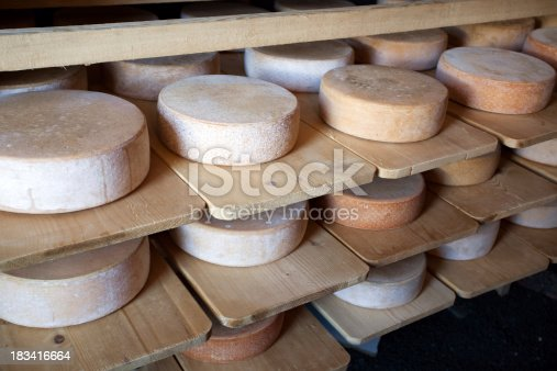 Swiss Alp-CheesesRow upon row of cheese stacked up in the cellar to mature.
