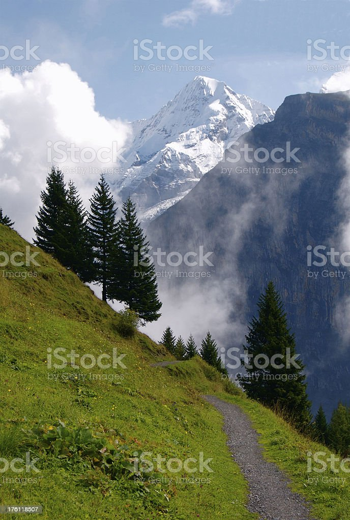Swiss Alpine Trail With The Eiger Looming Above stock photo