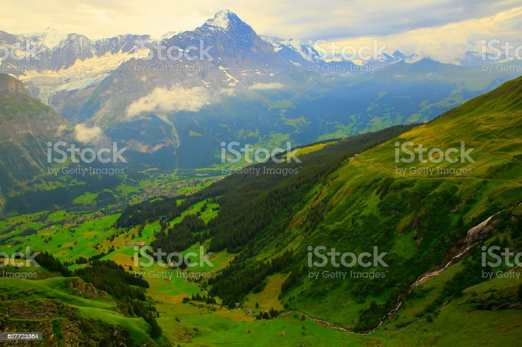 Swiss Alps: Eiger massif, river cascade above Grindelwald, dramatic evening stock photo
