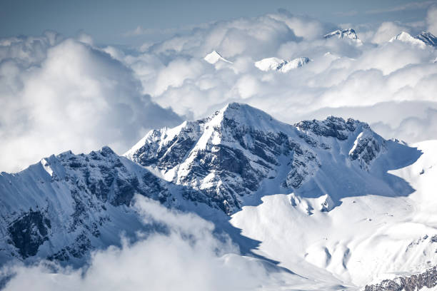 swiss alps in the clouds, switzerland stock photo