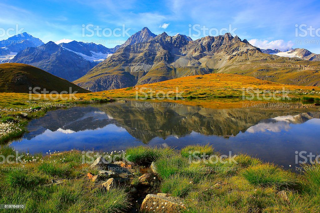 Swiss alps, lake reflection, golden autumn alpine meadow, Zermatt stock photo
