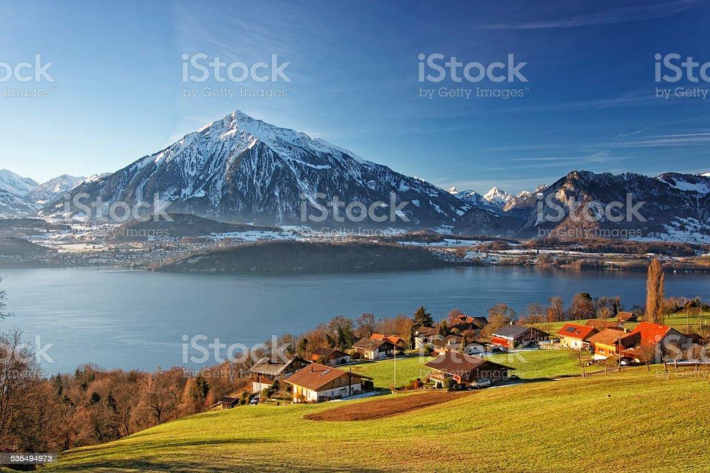 Swiss Alps mountains and lake view near Thun lake stock photo
