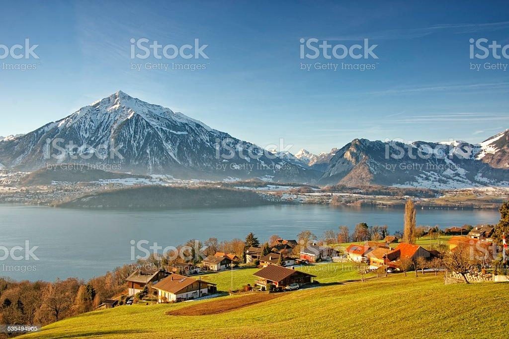 Swiss Alps peaks and lake view near Thun lake stock photo