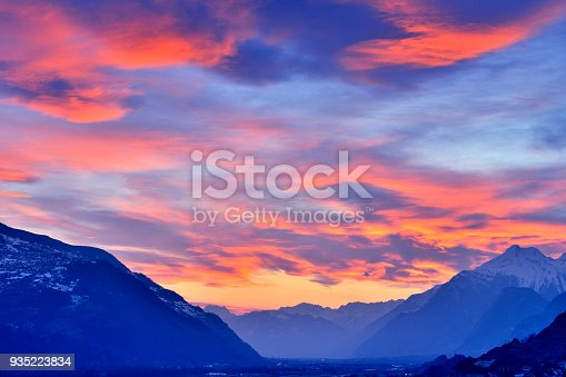 Swiss alps's valley at dramatic sky in sunset, Sion, Switzerland.