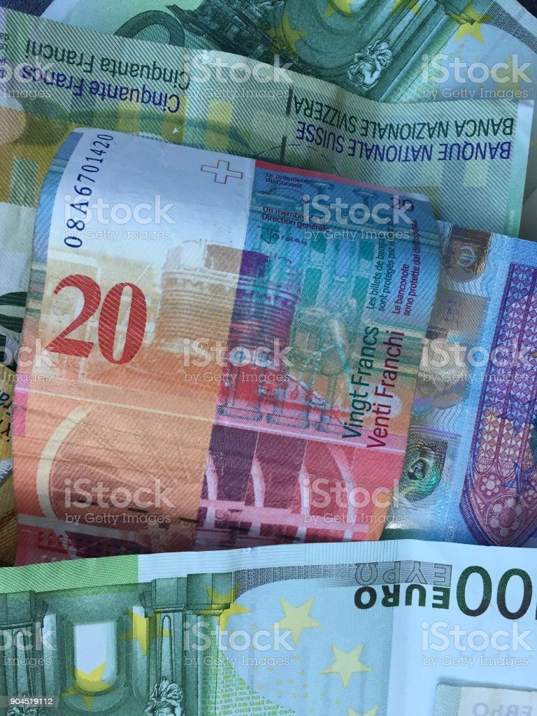 Swiss and euro banknotes stock photo