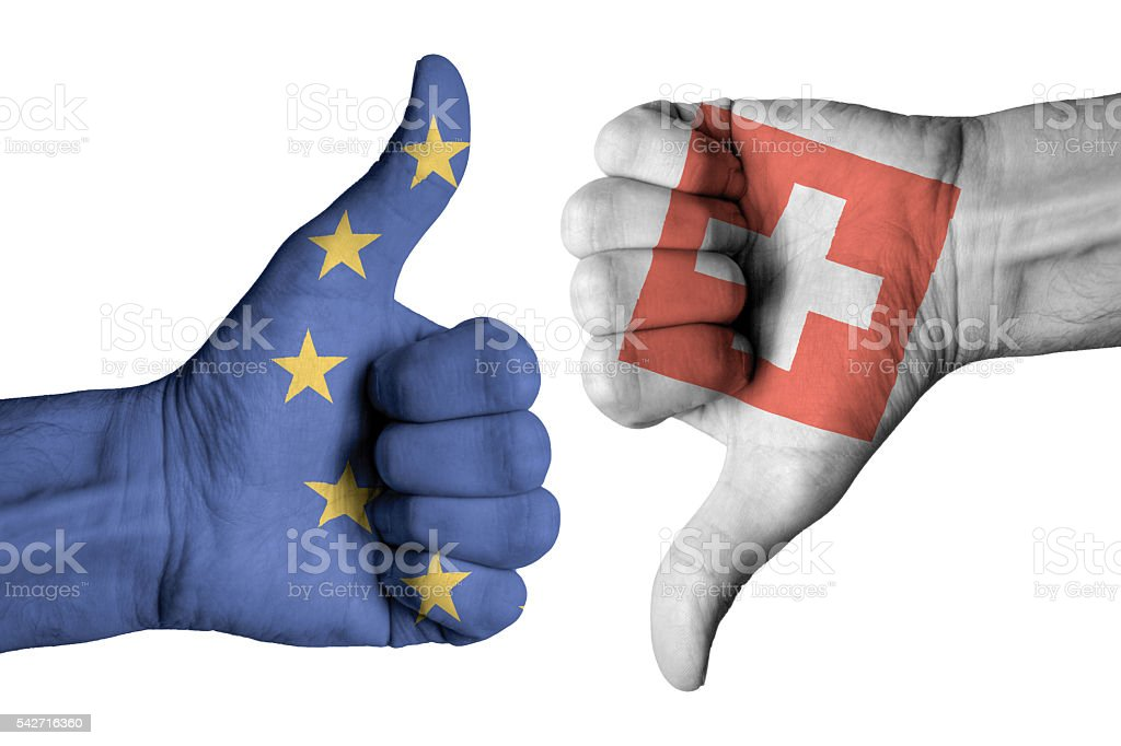 Swiss and Europe flag on human male hands – Foto