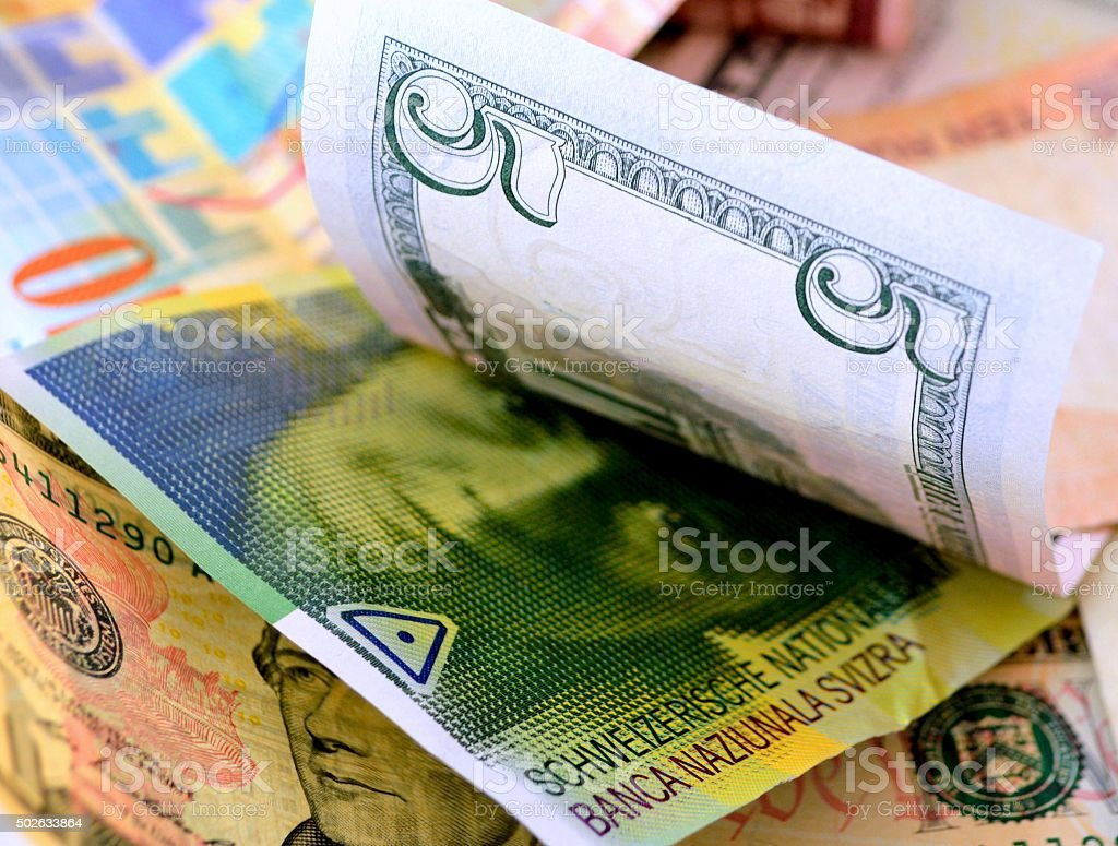 Swiss and US currency stock photo
