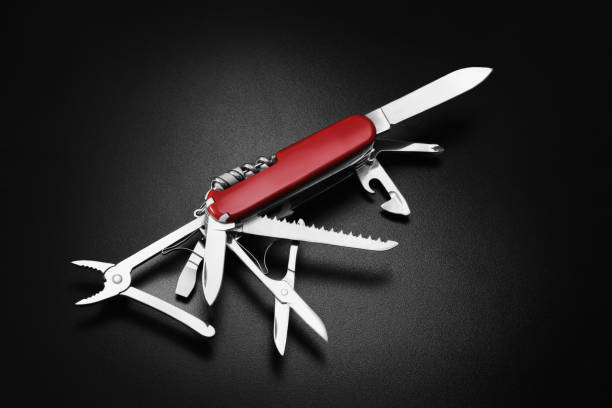 swiss army knife on black background - swiss army knife imagens e fotografias de stock
