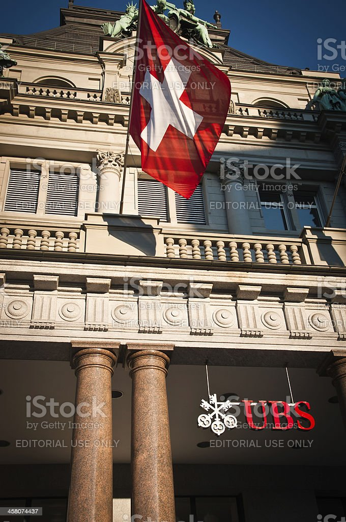 Swiss Bank Ubs Building With Waving Flag Of Switzerland