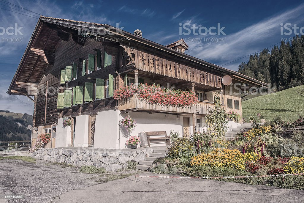 Swiss Chalet in the Alps royalty-free stock photo