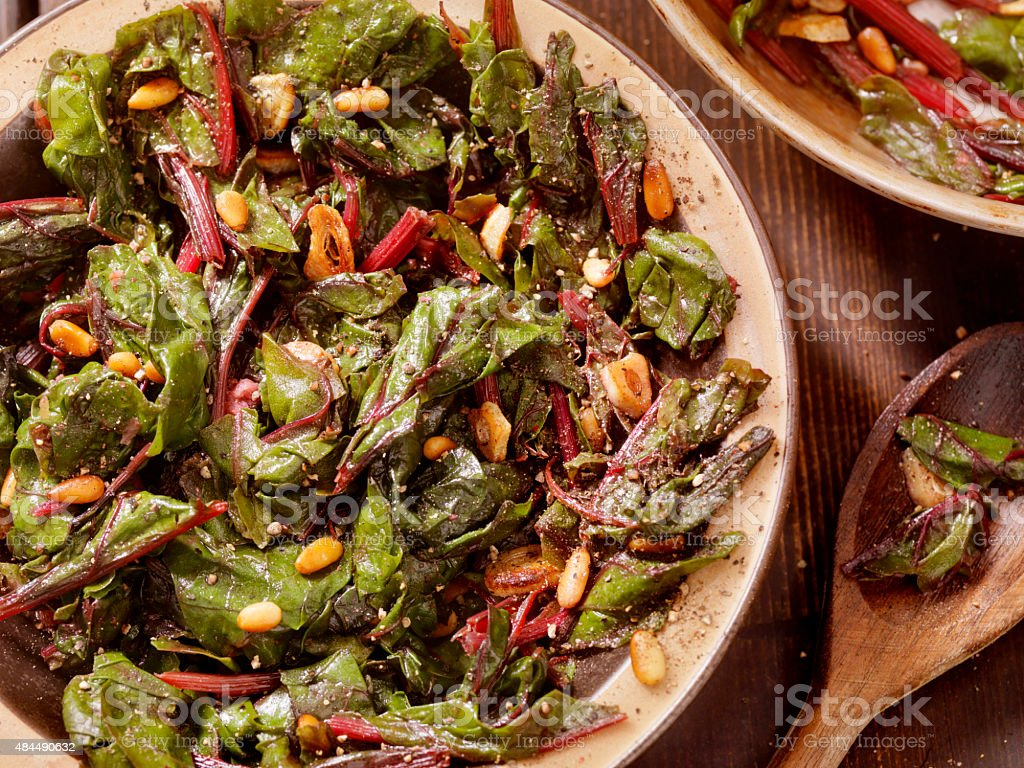Swiss Chard Sautéed with Garlic,Olive Oil and Pine Nuts stock photo