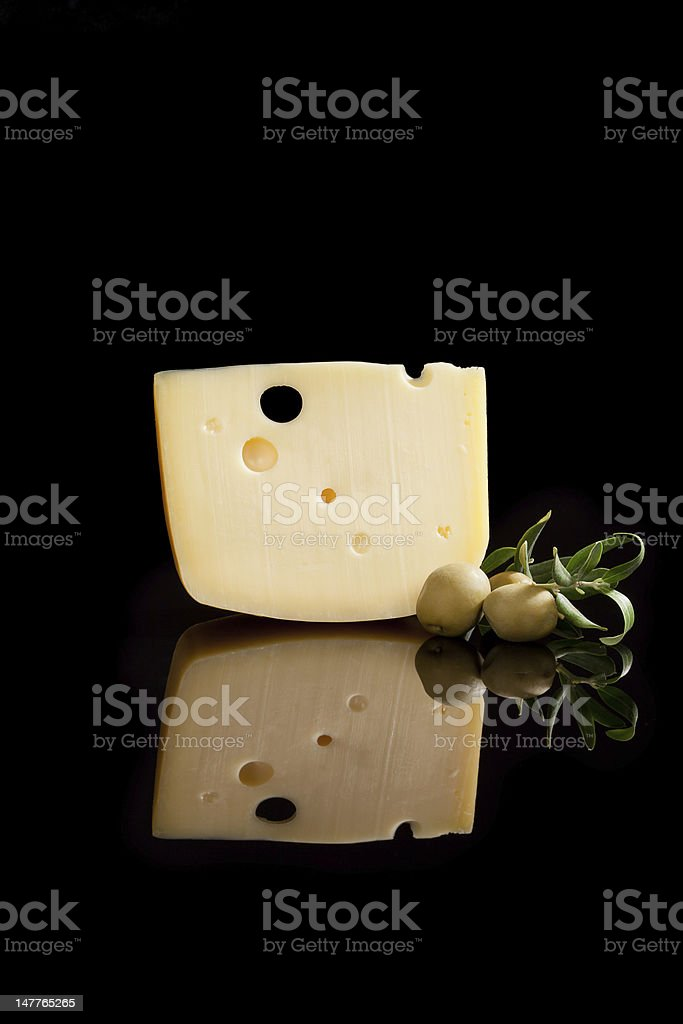 Swiss cheese and olives isolated. royalty-free stock photo