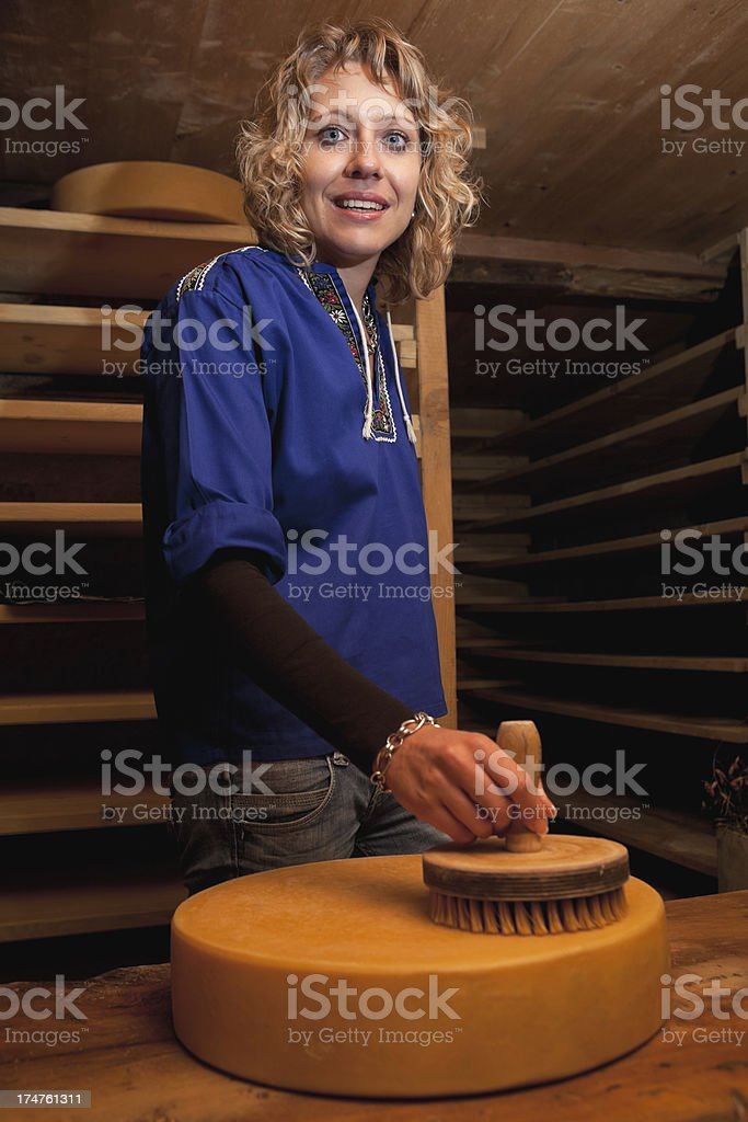 Swiss Cheese Making Process - Brushing and Maturation stock photo