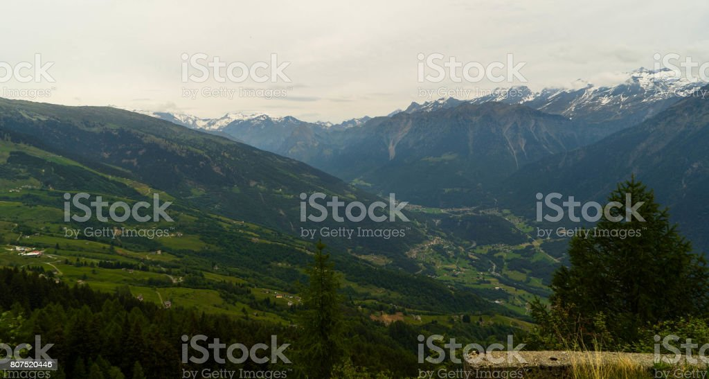 Swiss cities and villages in the Alpine mountains in Canton Tessin from a height of 2800 meters. stock photo