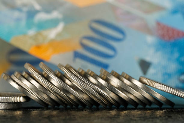 Swiss coins and Swiss banknote stock photo