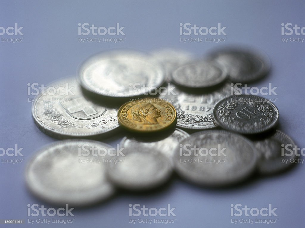 Swiss coins on the blue background. royalty-free stock photo