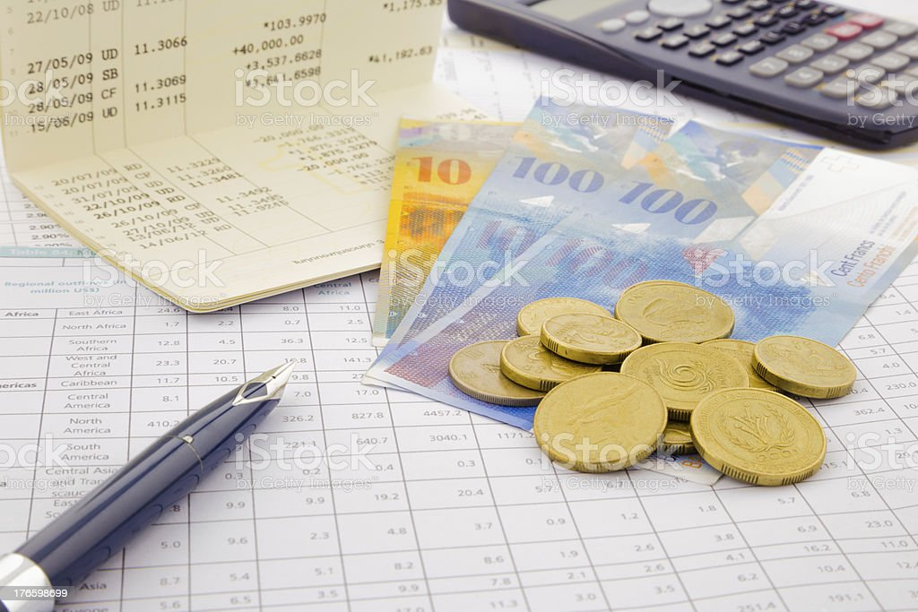 Swiss currency and money saving royalty-free stock photo