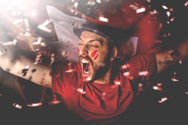 swiss fan celebrating with the national flag - adeptos imagens e fotografias de stock