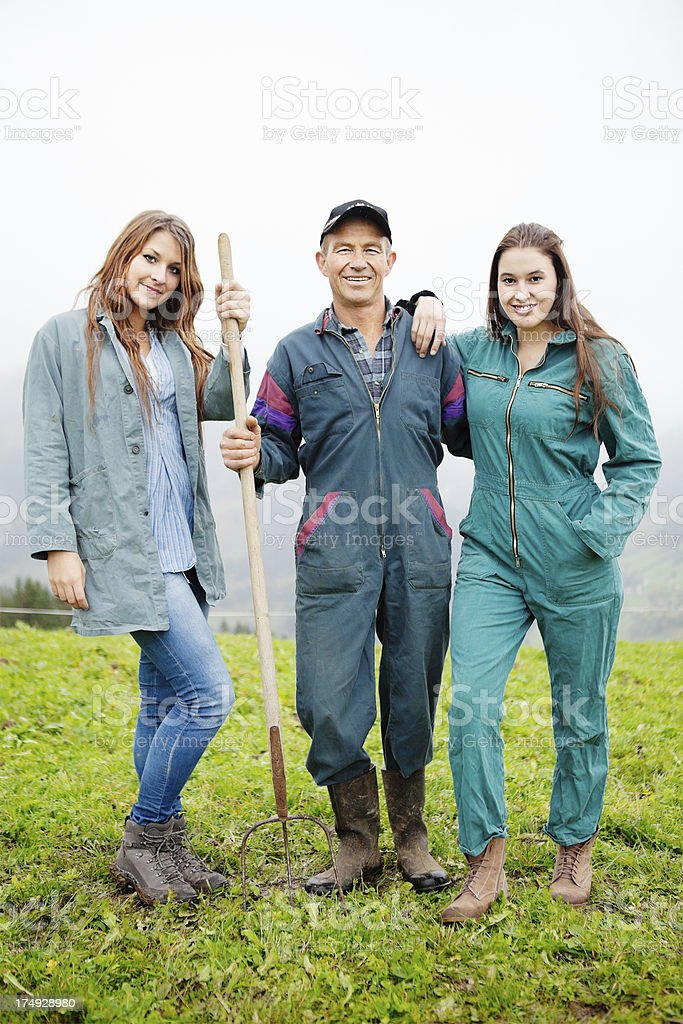 Swiss Farmer and his Daughters royalty-free stock photo