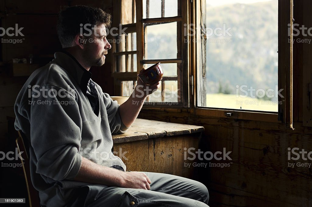 Swiss farmer with his morning coffee watching Alps stock photo