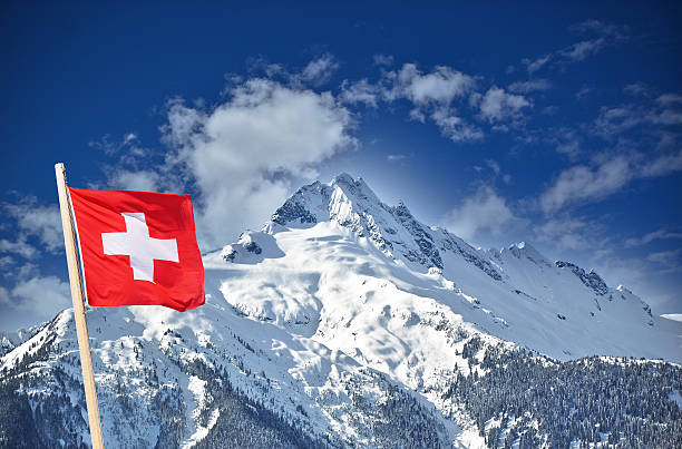 Swiss flag and snow mountain stock photo